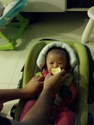 Daddy's idea of a celebration - letting Emma try his apple. Her first contact with real food.